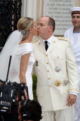 The bride & groom steal a kiss