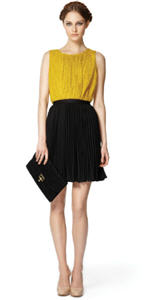 Gold peplum top ($32.99), Black pleated skirt ($29.99), Black lace clutch ($29.99)