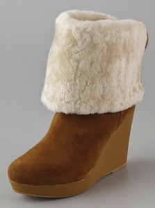 20dc9c42fba KORS Michael Kors Horwich Suede Wedge Boots - SHEfinds