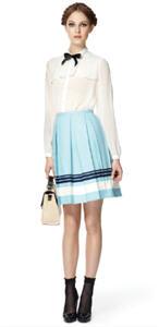 Sheer blouse ($34.99), Canvas skirt ($29.99), Straw bag ($39.99)
