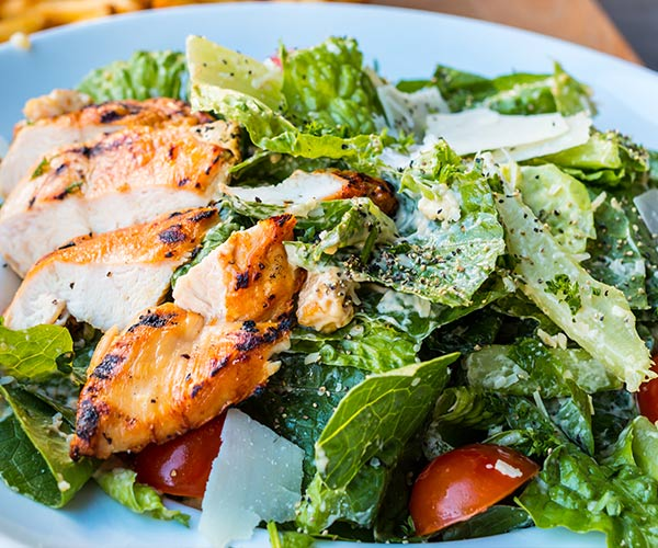 Add chicken to salad for a healthy protein
