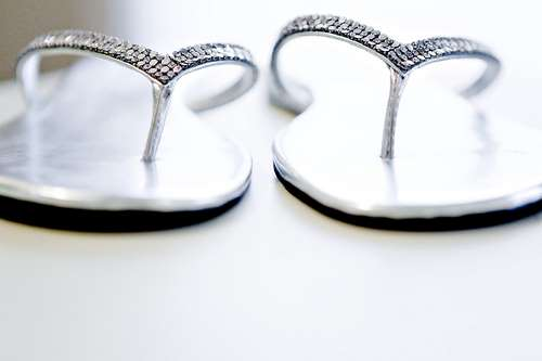 58ea4e36285848 DIY  Bedazzled Flip Flops  An easy craft for your bridemaids to take home  after the wedding is to make them sparkly flip flops. A good tutorial is  here.