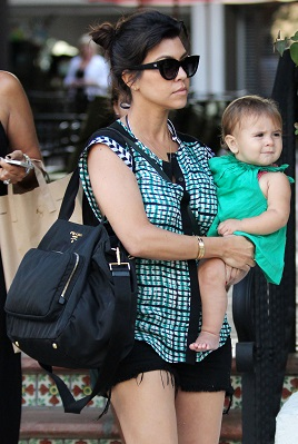 555dc8e47957 Who says diaper bags can't be stylish? Just check out Kourtney Kardashian's Prada  Nylon Baby Bag.