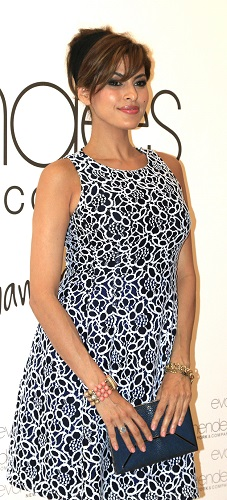 Eva Mendes looks stunning as she wears her own designs