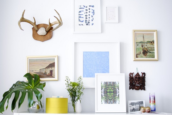 Give your walls dimension by pairing wall sculptures with traditional prints and pictures