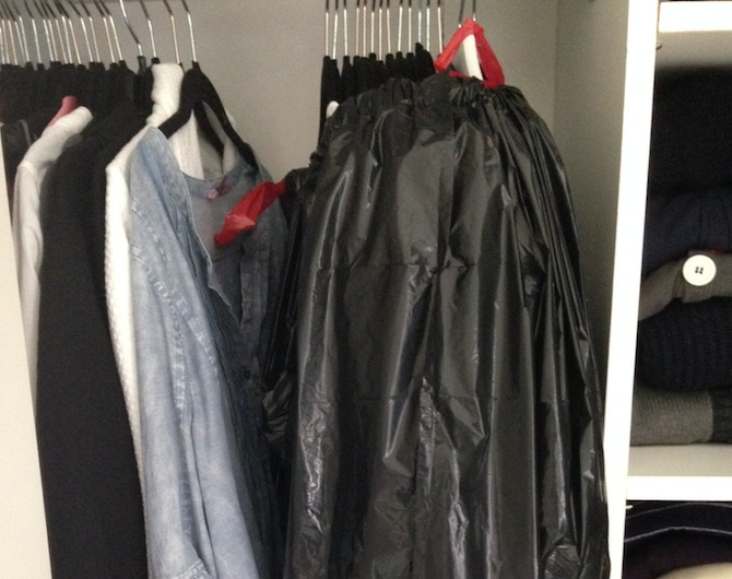Use garbage bags for your hanging clothes.