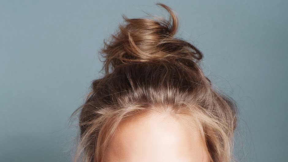 You Should Be Sleeping With Your Hair In A Bun Every Night