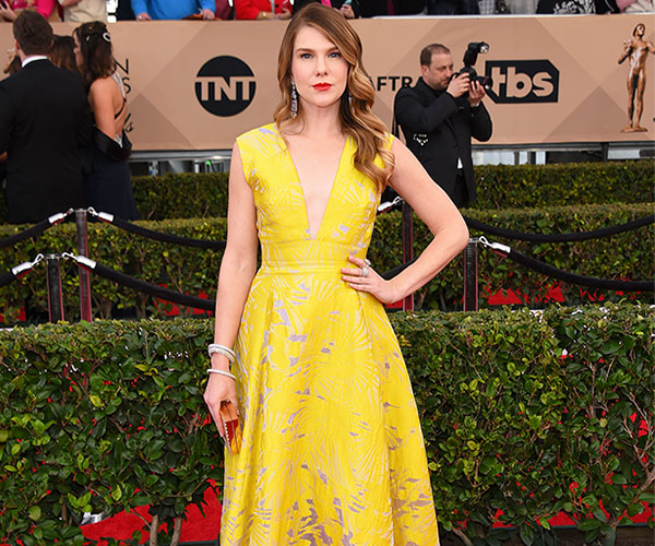 Lily Rabe with yellow in this Lela Rose gown.