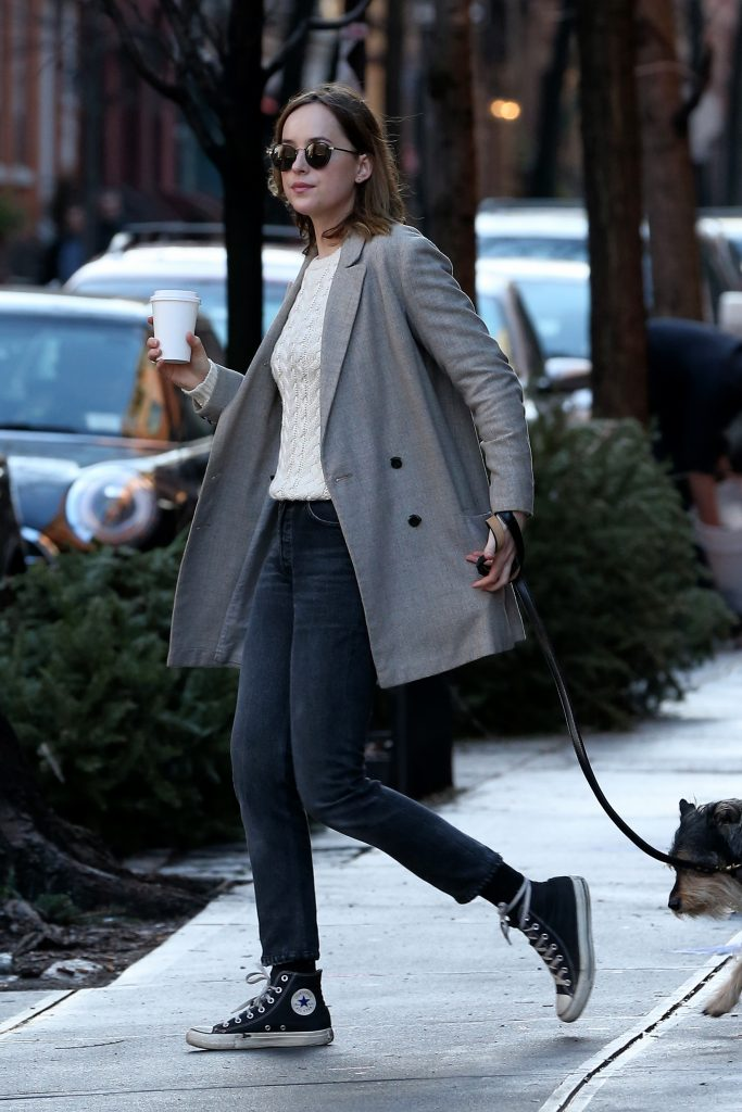 Actress Dakota Johnson grabs a coffee at Saturdays in West Village with dog Zeppelin in New York City on January 10, 2015. Pictured: Dakota Johnson Ref: SPL1206154 100116 Picture by: Christopher Peterson/Splash News Splash News and Pictures Los Angeles:310-821-2666 New York: 212-619-2666 London: 870-934-2666 photodesk@splashnews.com