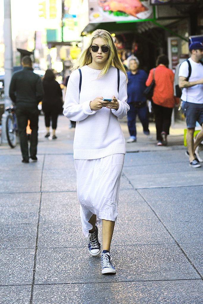 Gigi Hadid was spotted texting on her cell phone in an all white outfit while out in New York City. Pictured: Gigi Hadid Ref: SPL849246 230914 Picture by: Sharpshooter Images / Splash Splash News and Pictures Los Angeles:310-821-2666 New York: 212-619-2666 London: 870-934-2666 photodesk@splashnews.com
