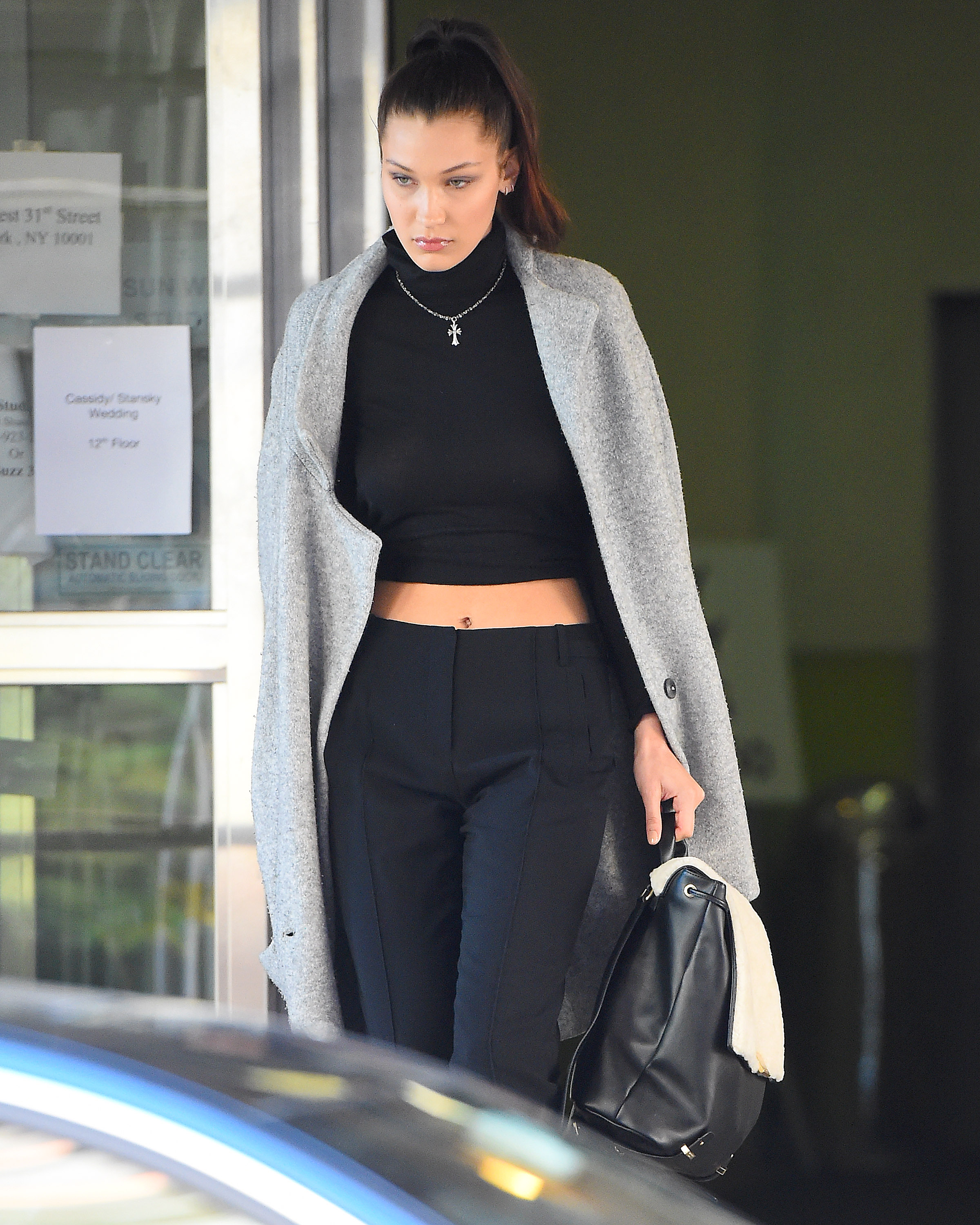 Bella Hadid seen wearing a black crop top and black slacks in New York City Pictured: Bella Hadid Ref: SPL1176729 141115 Picture by: Robert O'neil/Splash News Splash News and Pictures Los Angeles:310-821-2666 New York: 212-619-2666 London: 870-934-2666 photodesk@splashnews.com