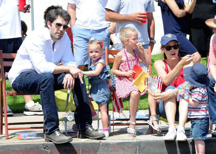 Ben Affleck kisses wife Jennifer Garner at 4th July parade in Los Angeles, Ca. The actors took both daughters Violet and Seraphina to the parade in the pacific palisades area of Los Angeles. Jennifer was seen waving to the floats and parade as she showed off her american pride buying flags for her two children. Violet even showed her patriotism by singing during the national anthem. They watched the parade for over an hour and Ben even Kissed Jen's hand during the festivities. Pictured: Ben Affleck, Jennifer Garner, Violet Affleck and Seraphina Affleck Ref: SPL294007 040711 Picture by: Whittle / Splash News Splash News and Pictures Los Angeles: 310-821-2666 New York: 212-619-2666 London: 870-934-2666 photodesk@splashnews.com