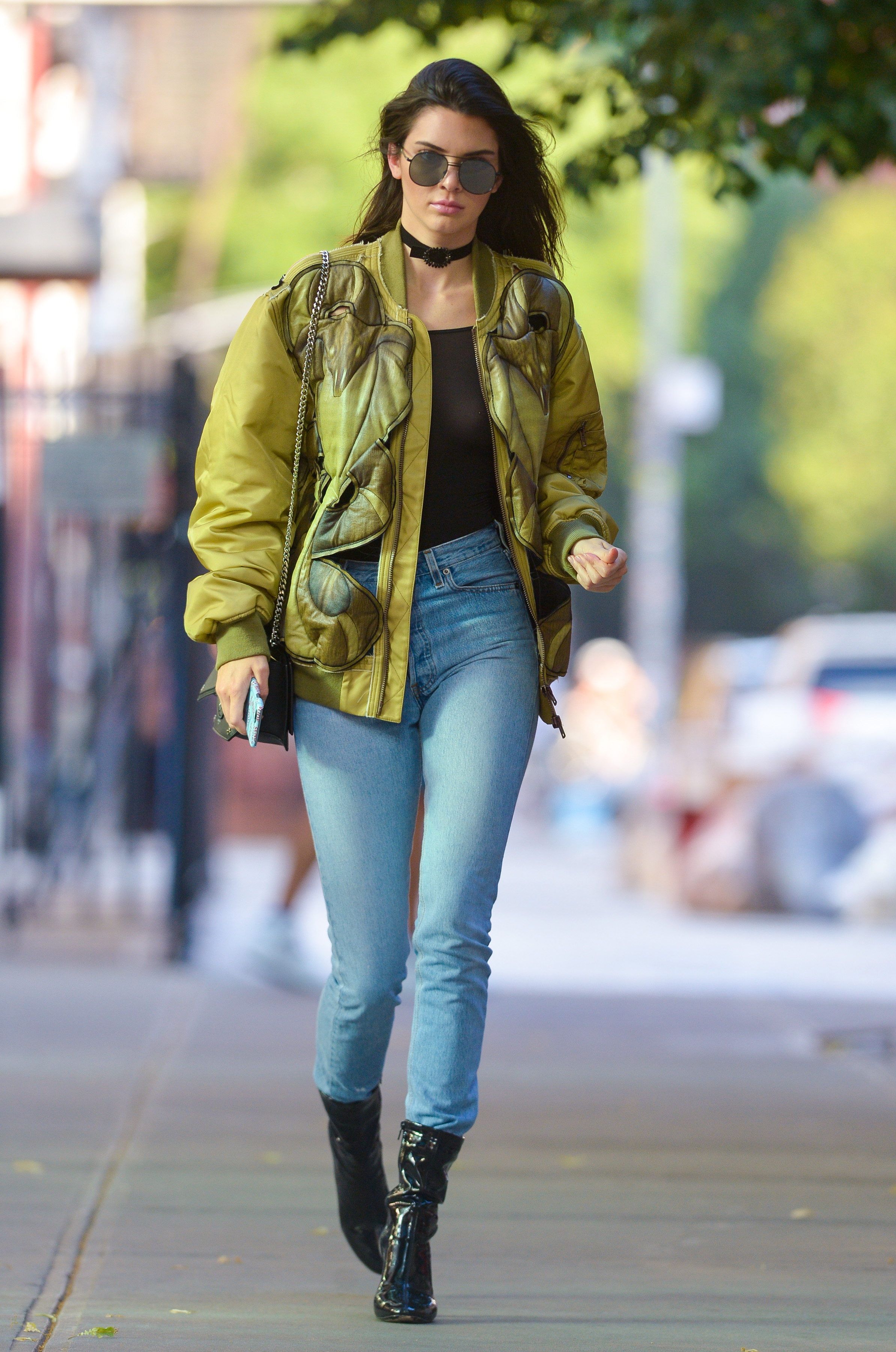 Kendall Jenner wears a black choker, a green jacket and jeans as she is seen walking in downtown Manhattan Pictured: Kendall Jenner Ref: SPL1305782 210616 Picture by: Wylde / Splash News Splash News and Pictures Los Angeles:310-821-2666 New York: 212-619-2666 London: 870-934-2666 photodesk@splashnews.com