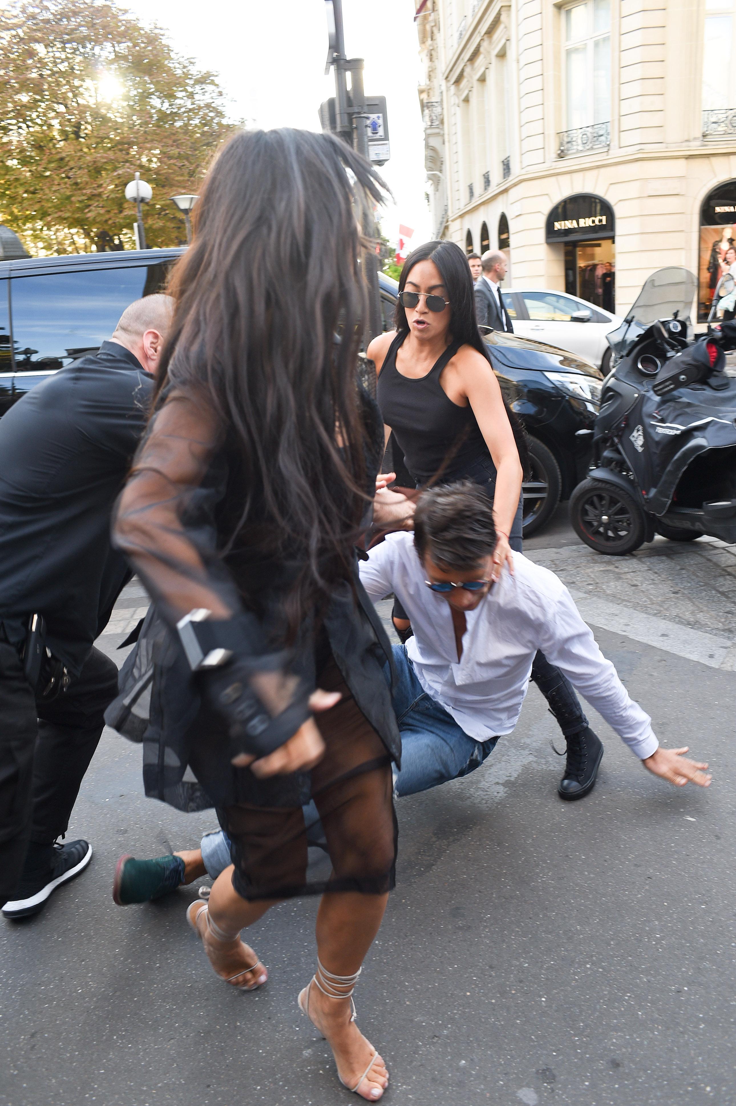 Celebrity pranker Vitalii Sediuk strikes again, this time grabbing Kim Kardashian at L'Avenue restaurant in Paris Pictured: Vitalii Sediuk ,Kim Kardashian Ref: SPL1363902 280916 Picture by: Neil Warner / Splash News Splash News and Pictures Los Angeles:310-821-2666 New York: 212-619-2666 London: 870-934-2666 photodesk@splashnews.com