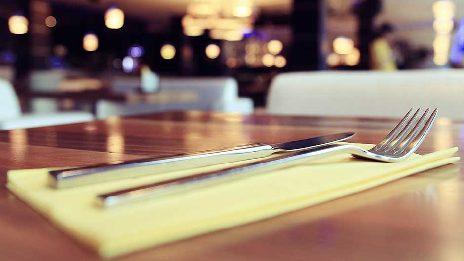 The Weird Reason You Should Never Use Metal Silverware At A Restaurant