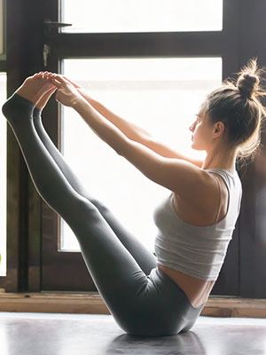 the best yoga poses for a flat stomach according to a