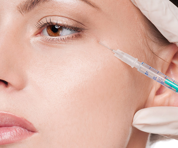 The Difference Between Fillers & Botox For 30-Year-Olds, According