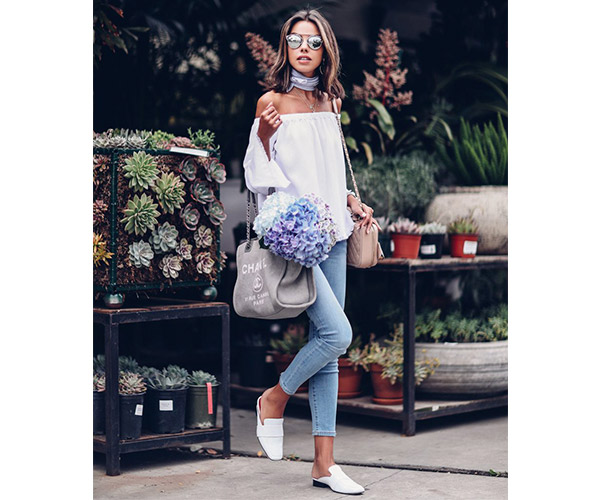 woman with white off the shoulder top and white mules