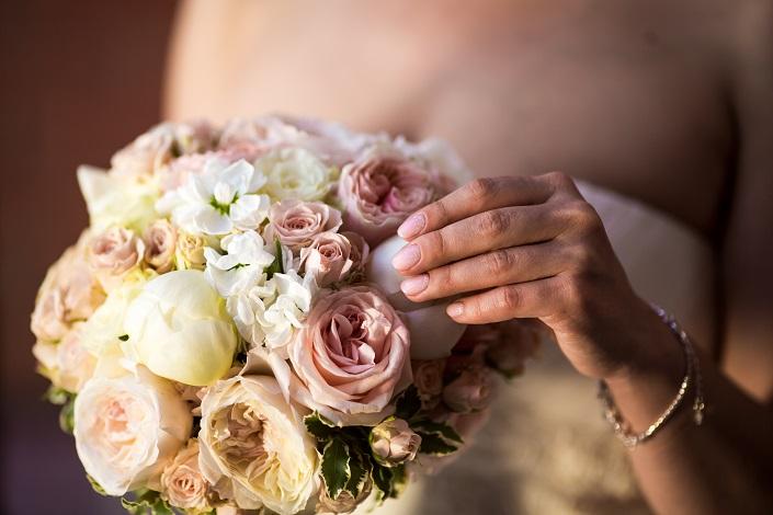 Carrying a light bouquet.