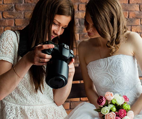 Bride with photographer