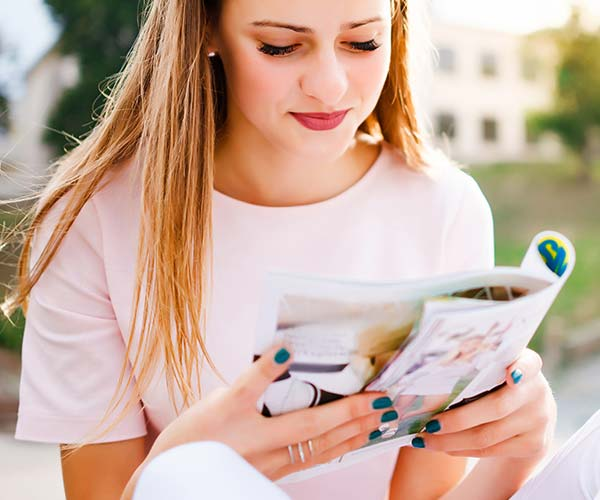 Woman reading women's magazine