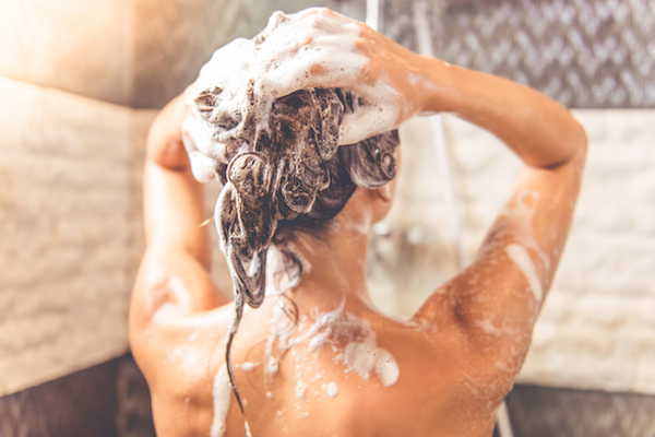 regular shampoo bad for hair girl washing shower