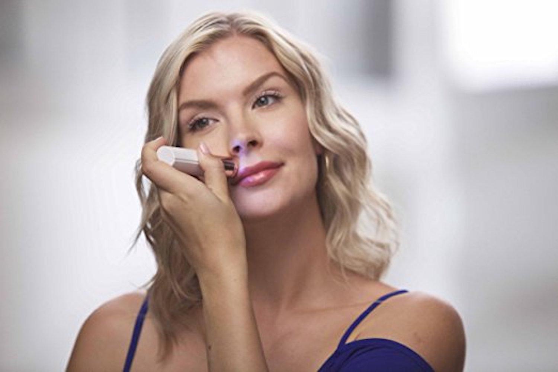 woman removing facial hair