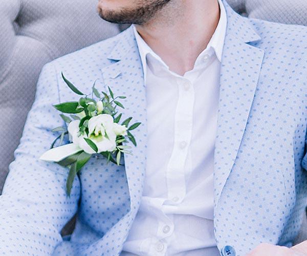 man in blue tuxedo at wedding