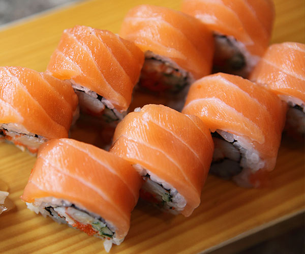 salmon sushi rolls on a plate