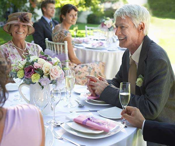older guests sitting at wedding table