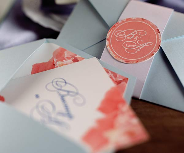 assorted wedding invitations and envelopes