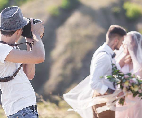 Photographer with couple