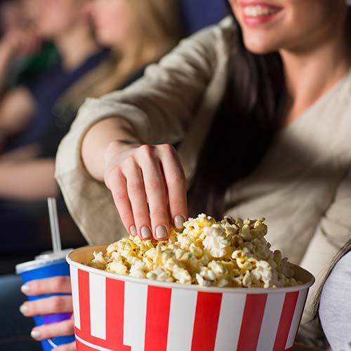 woman eating popcorn at movies