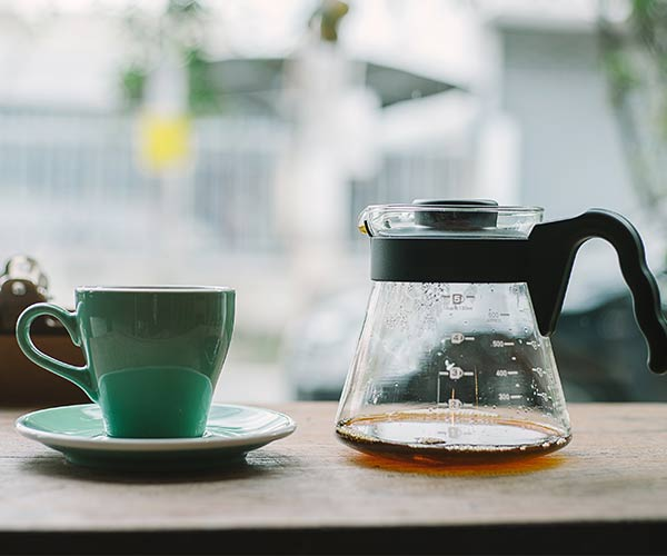 coffee and coffee pot on diner counter