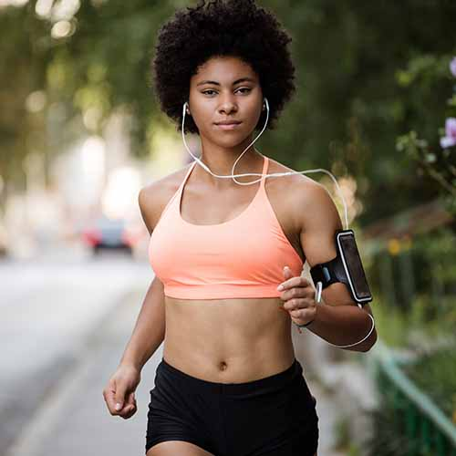 woman running listening to headphones