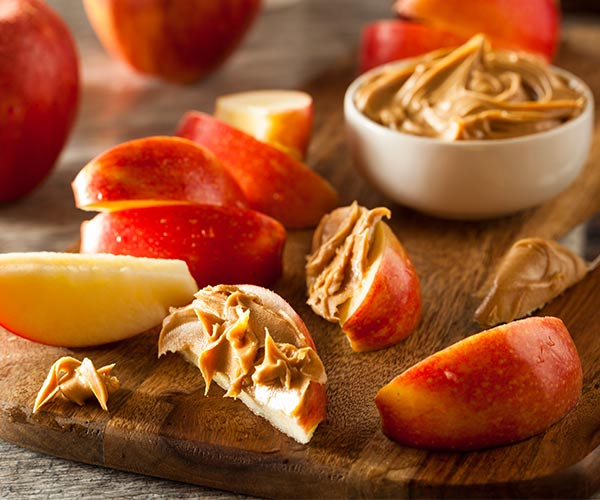 apples and peanut butter on a plate