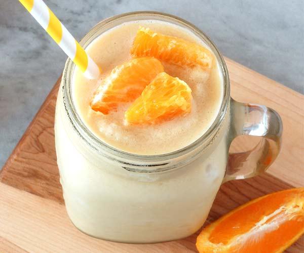 orange smoothie with orange slices in it