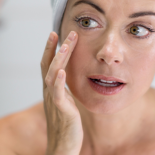 woman applying skincare product