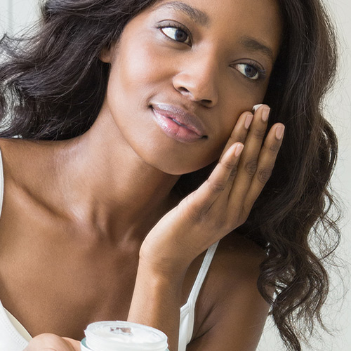 woman applying skincare products