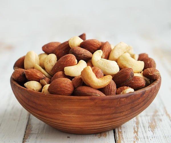 assorted nuts in a bowl on a table