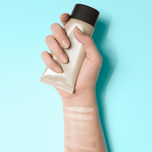 woman holding tinted moisturizer
