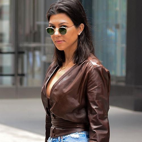 0073b457f0a You May Need To Sit Down Before You See The Totally Bizarre Bikini Kourtney  Kardashian Just