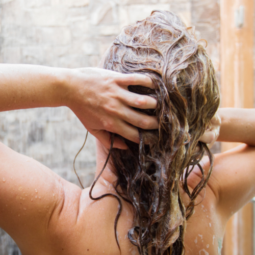 The One Conditioner You Should START Using To Prevent Thinning Hair, According To A Dermatologist