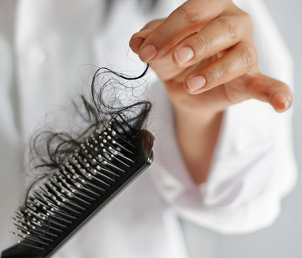 4 Cheap Natural Supplements Dermatologists Swear By To Stop Hair Loss