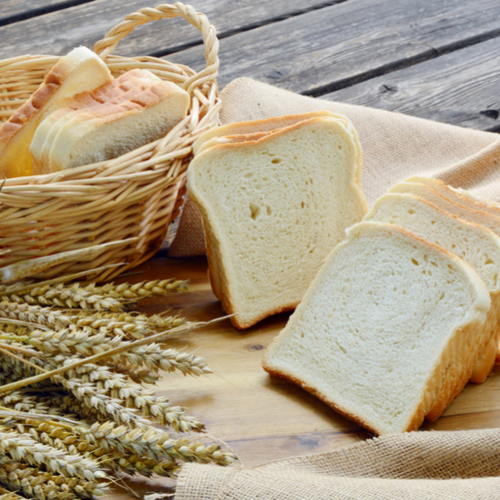 white bread basket on a table
