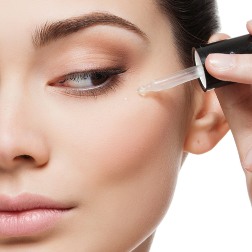woman applying skin serum to face