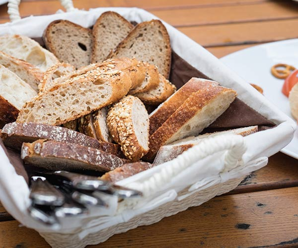 restaurant bread basket with assorted bread