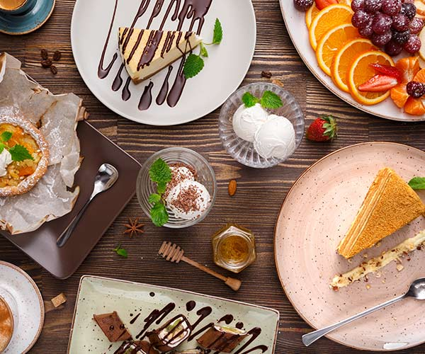 assorted desserts on a wooden table