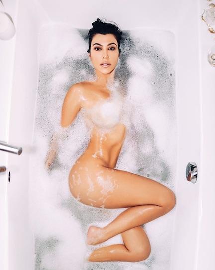 kourtney kardashian posing naked in a bathtub