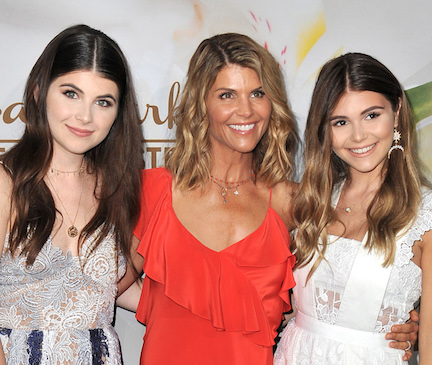 lori loughlin on the red carpet with her daughters olivia jade and isabella rose
